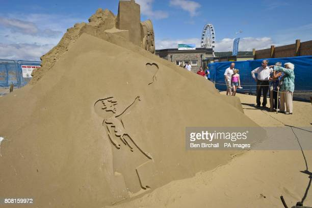 A sculpture of Banksy's little girl with balloon in the WestonsuperMare Sand Sculpture Festival on the beach which this year has the theme and...
