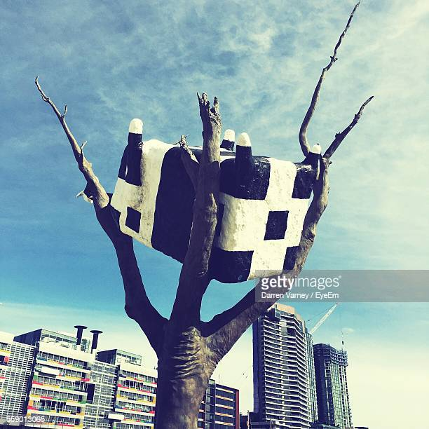 Sculpture Of Cow On Bare Tree