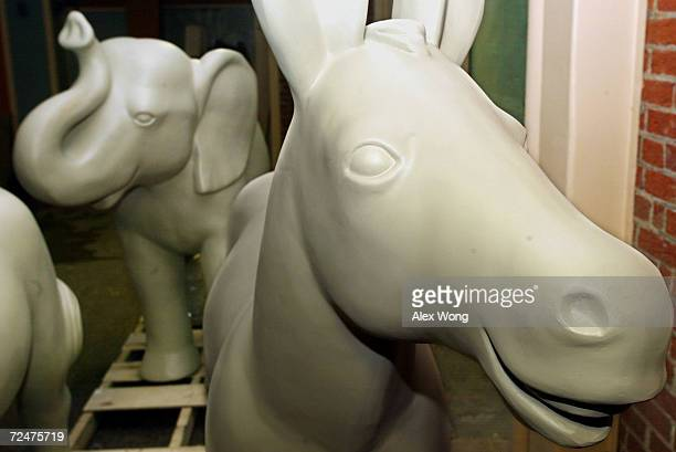 A sculpture of donkey symbol of the Democratic Party and a sculpture of elephant symbol of the Republican Party are placed February 20 2002 at a...
