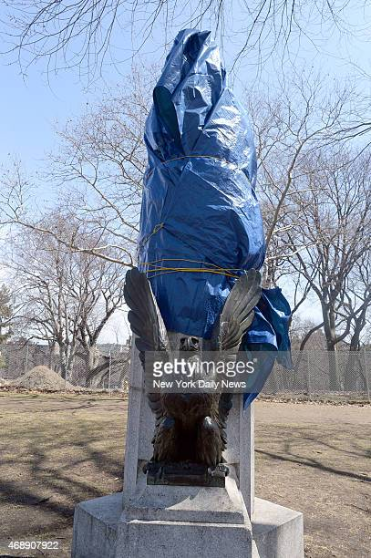 A sculpture of Edward Snowden is taken down from atop a column in Brooklyn's Fort Greene Park The NYC Parks Department covered it with a tarp before...