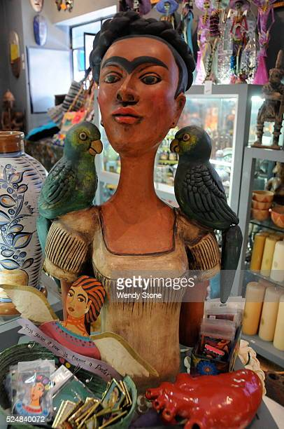 Sculpture of Frida Kahlo with parrots in an arts and crafts shop in Ajijic Mexico Selection of Frida Kahlo souvenirs for tourists