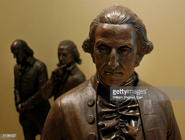 A sculpture of George Washington is seen on display in Signers Hall where visitors can walk among delegates of the Constitutional Convention during a...