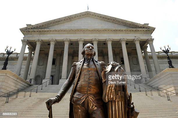 A sculpture of George Washington stands infront of the State Capitol Building before South Carolina Gov Mark Sanford held a press conference at the...