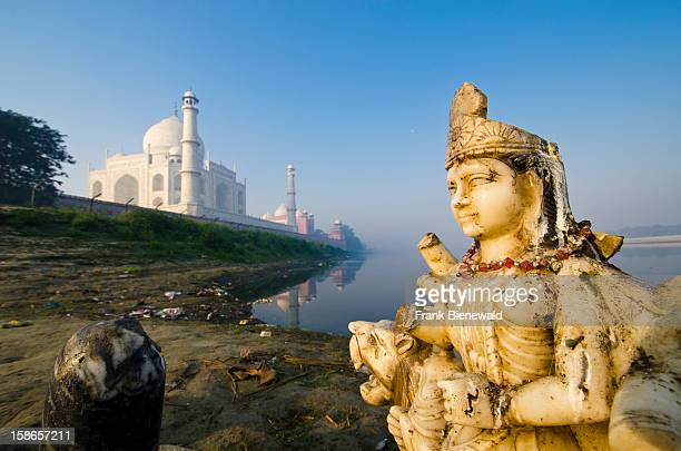Sculpture of Godess Durga at the banks of the river Yamuna the Taj Mahal in the background