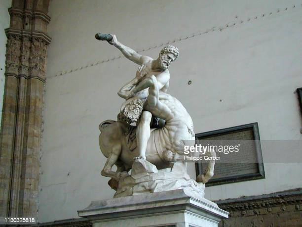 sculpture of hercules and nessus in the loggia dei lanzi hall, florence - hercules stock pictures, royalty-free photos & images