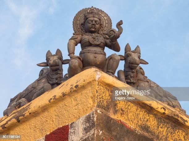 Sculpture of Hindu deity on the corner of Kumari Amman temple in Kanyakumari
