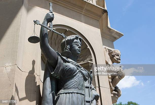 Sculpture of Justitia goddess of justice here in blindfolded next to the main entrance of the town hall in Wuppertal/Elberfeld