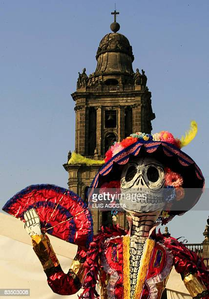 A sculpture of La Catrina a symbol representing death or the skull in Mexican folklore is displayed during celebrations for the Day of the Dead at...