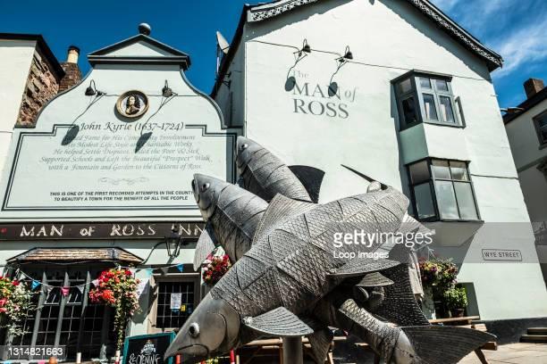 Sculpture of leaping salmon outside the Man of Ross Inn.