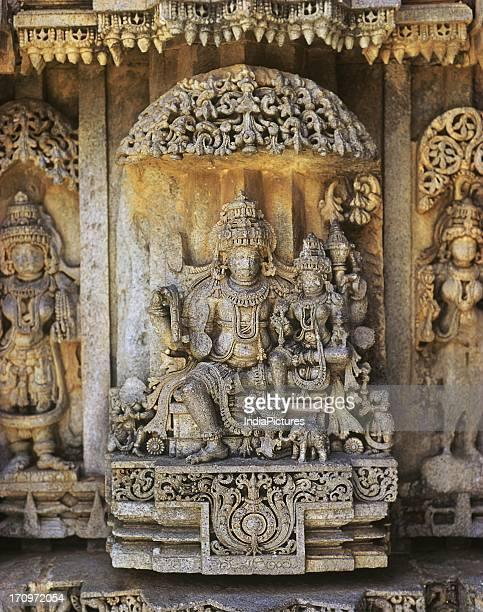 Sculpture of Lord Vishnu and Goddess Lakshmi in Prasanna Keshava Temple, Somnathpur, Karnataka, India.