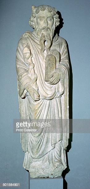 Sculpture of Moses from the Chapter House of St Mary's Abbey York He carries the Law tablets and a staff around which twists the brazen serpent His...