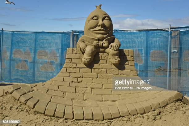 A sculpture of nursery rhyme character Humpty Dumpty in the WestonsuperMare Sand Sculpture Festival on the beach which this year has the theme and...