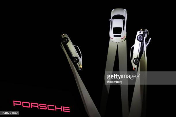 A sculpture of Porsche 911 automobiles stands on display outside the Porsche AG factory in Stuttgart Germany on Tuesday Aug 29 2017 The Porsche...