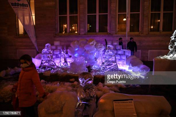 Sculpture of the Christmas nativity scene made of ice is displayed on December 23, 2020 in Turin, Italy. While decorations go up to celebrate the...