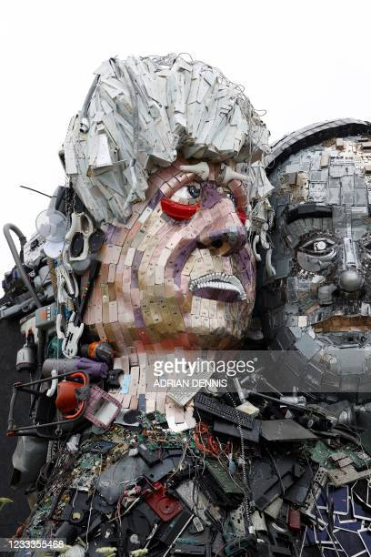 Sculpture of the head of Britain's Prime Minister Boris Johnson is displayed as an element of a giant Mount Rushmore-style sculpture of the G7...