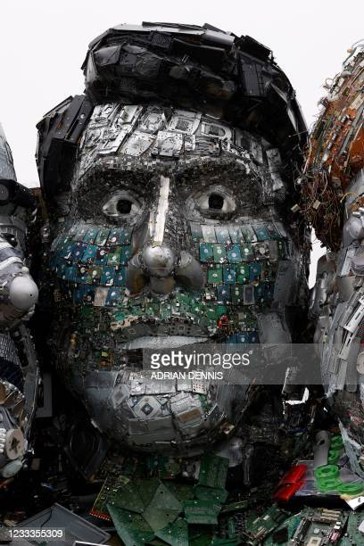 Sculpture of the head of Canada's Prime Minister Justin Trudeau is displayed as an element of a giant Mount Rushmore-style sculpture of the G7...