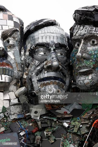 Sculpture of the head of Italy's Prime minister Mario Draghi is displayed as an element of a giant Mount Rushmore-style sculpture of the G7 leaders...