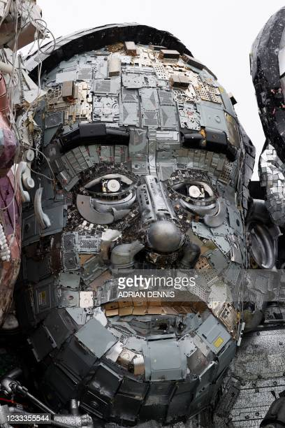 Sculpture of the head of Japan's Prime Minister Yoshihide Suga is displayed as an element of a giant Mount Rushmore-style sculpture of the G7 leaders...