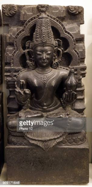 Sculpture of the Indian planet of the Mars holding a water pot in one hand and prayer beads in another Dated 17th Century
