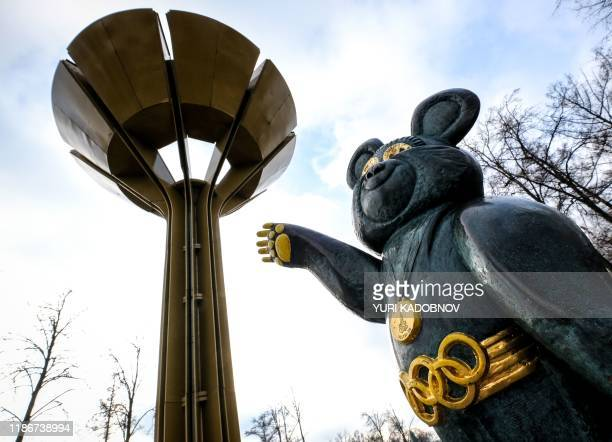 A sculpture of the mascot for the 1980 Moscow Olympics Misha the bear stands next to the 1980 Summer Olympics Cauldron near the Luzhniki stadium in...