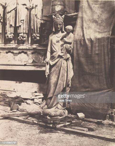 Sculpture of Virgin and Child. Notre Dame. Paris. Circa 1851. Salted paper print from paper negative. 35.1 x 27.6 cm . Photographs. Auguste Mestral ....