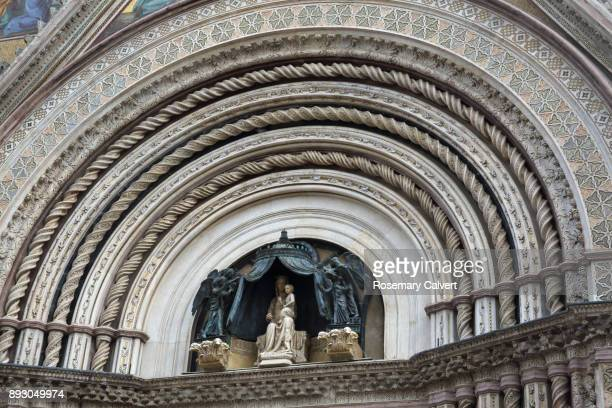 Sculpture of Virgin Mary on facade of Orvieto Cathedral