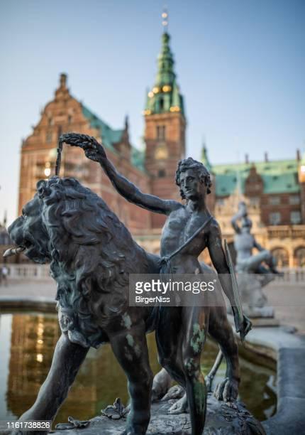 sculpture on neptune fountain, frederiksborg castle, hillerød, denmark - frederiksborg castle stock pictures, royalty-free photos & images