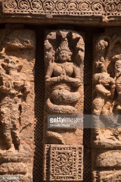 Sculpture on sun temple wall, konark, orissa, india, asia