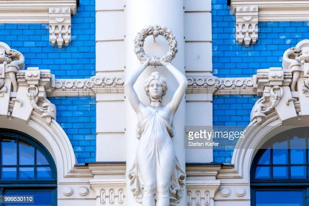 sculpture on the facade of building no. 4 strelnieku iela street, art nouveau, riga, latvia - art nouveau stock pictures, royalty-free photos & images