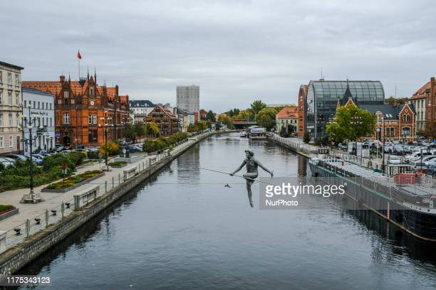 Sculpture suspended on a cable is seen over the Brda river in Bydgoszcz, Poland on October 11, 2019. The sculpture was placed after Poland joined the...