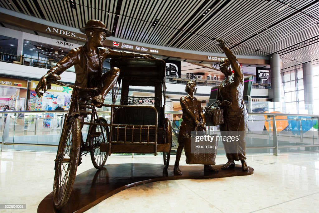A sculpture titled 'Hey, Ah Chek' by Chong Fah Cheong is stands in the departure check-in hall during a media preview of the new Terminal 4 (T4) at Changi Airport in Singapore, on Tuesday, July 25, 2017. The terminal which will open later this year, will feature an array of fast and seamless travel (FAST) technologies to speed people-processing without the need for human supervision, from face-recognition software to automated bag-tagging and checking. Photographer: Nicky Loh/Bloomberg via Getty Images