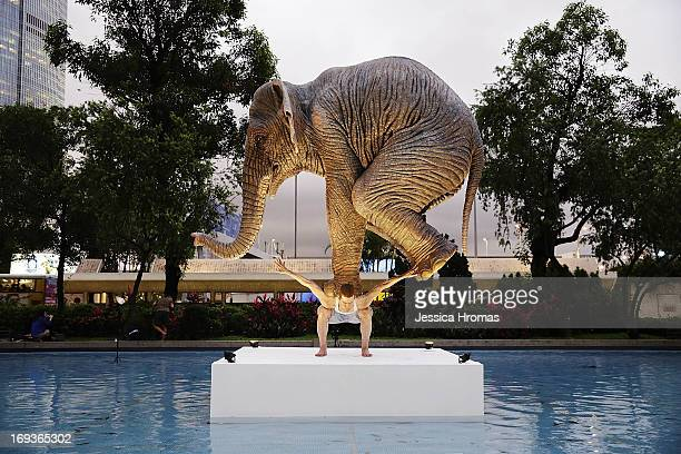 A sculpture titled 'Pentateuque' representing an elephant balancing on the back of a man by French artist Fabien Merelle on May 23 2013 in Hong Kong...