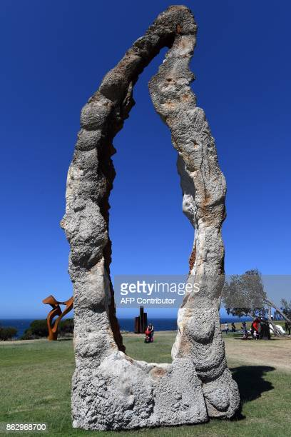 A sculpture 'Walking Woman' by US artist Peter Lundberg is seen as part of the 'Sculpture by the Sea' exhibition near Bondi beach in Sydney on...