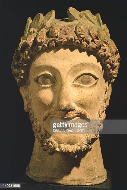 Sculpture with polycrome traces depicting the head with a laurel wreath of an Aphrodite priest ca 500 BC from Athienou Cyprus Cypriot Civilization...