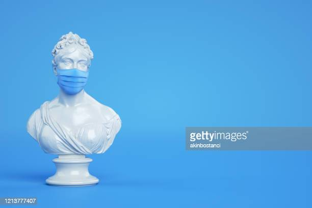 sculpture with protective medical mask - sculpture stock pictures, royalty-free photos & images