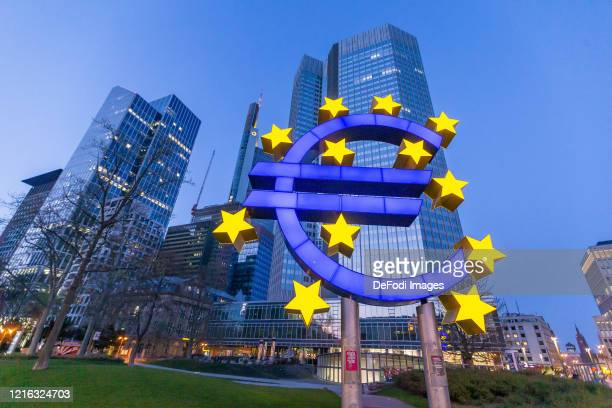 Sculpture with the euro logo in front of the European Central Bank building on March 27 2020 in Frankfurt am Main Germany