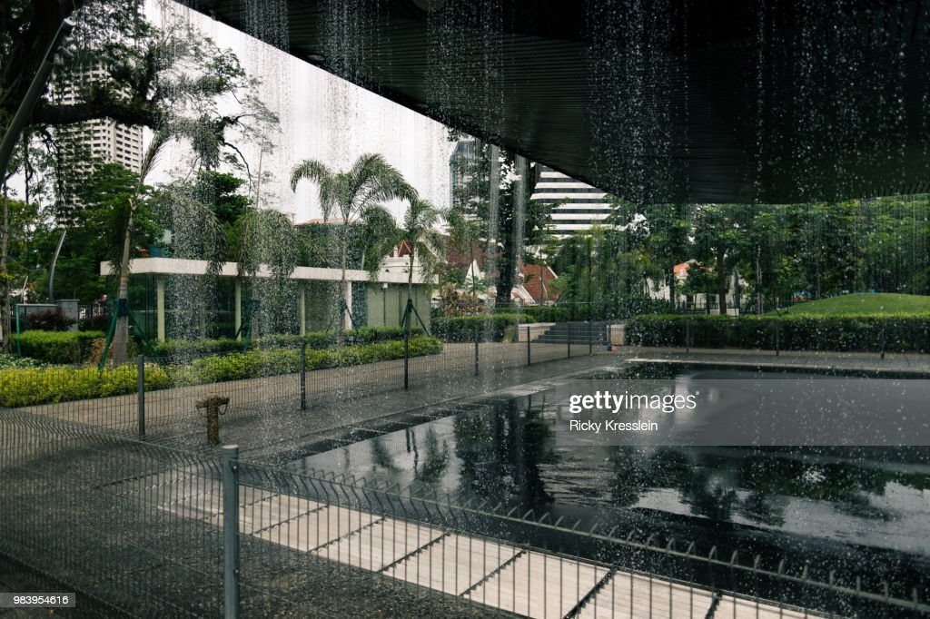 sculpture with waterfall walls stock photo getty images