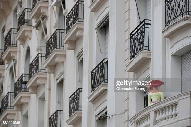 Sculptures adorn a hotel balcony on the Boulevard de la Croisette during the Cannes Film Festival on May 18 2017 in Cannes France Celebrities fans...