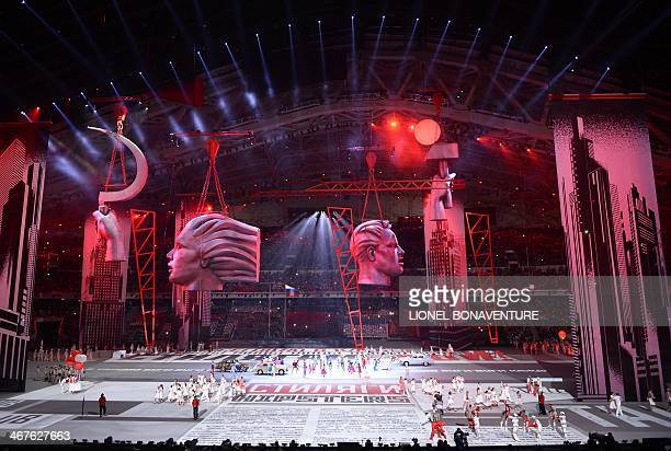Sculptures and a hammer and sickle are seen floating over street scene during the Opening Ceremony of the Sochi Winter Olympics at the Fisht Olympic...