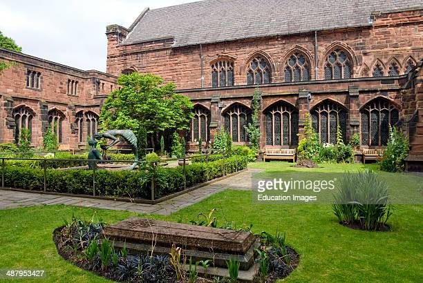 Sculptures at the Garden of Remembrance at in the cloister garth of Chester Cathedral Cheshire North West England
