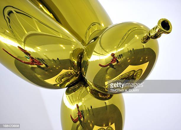 Sculptures by artist Jeff Koons related to the Celebration series Balloon Rabbit is on display during a press preview for Koons's first major...
