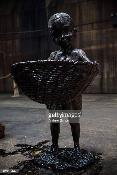 Sculptures depicting child laborers made in part out of unrefined sugar is displayed as a part of artist Kara Walker's A Subtlety at the former...
