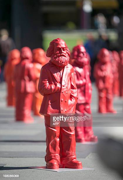 Sculptures figuring socialist Karl Marx stand as part of an installation on a public square around the World Heritage site Porta Nigra in Marx'...