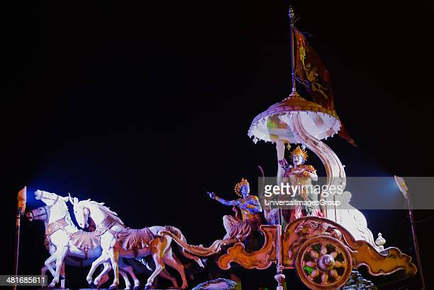 Sculptures of a chariot of lord Krishna and Arjuna at the entrance of Ganga ghat Muni Ki Reti Rishikesh Dehradun District Uttarakhand India