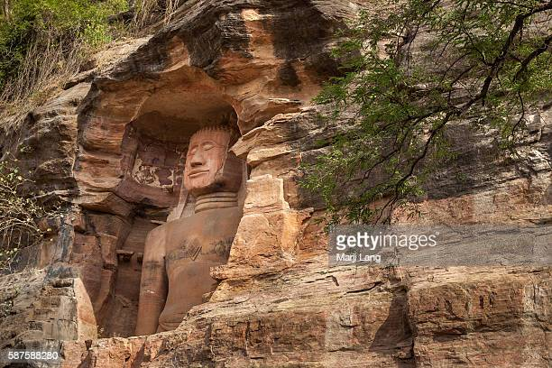 Sculptures of Jain Tirthankaras or saviours dating between the 7th and the 15th centuries are cut into the rocks along the steep sides of the road...