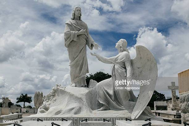 Sculptures of Jesus Christ and archangel at the Necropolis Cristobal Colon in Havana, Cuba