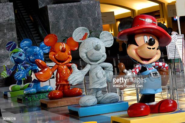 Sculptures of Mickey Mouse stand in the Grand Hall of the Philadelphia Convention Center during the 2004 Walt Disney Company shareholders meeting...
