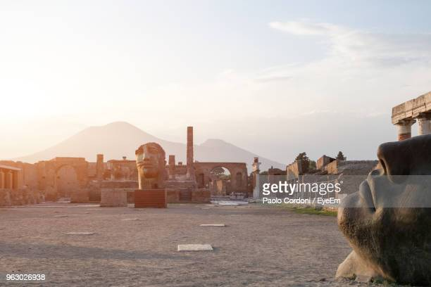 sculptures on landscape against sky - pompeii stock photos and pictures