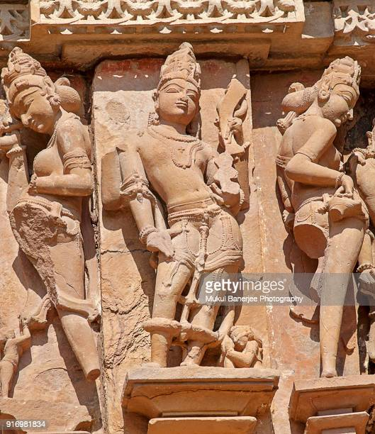 Sculptures on the walls of famous Khajuraho Temples in India.