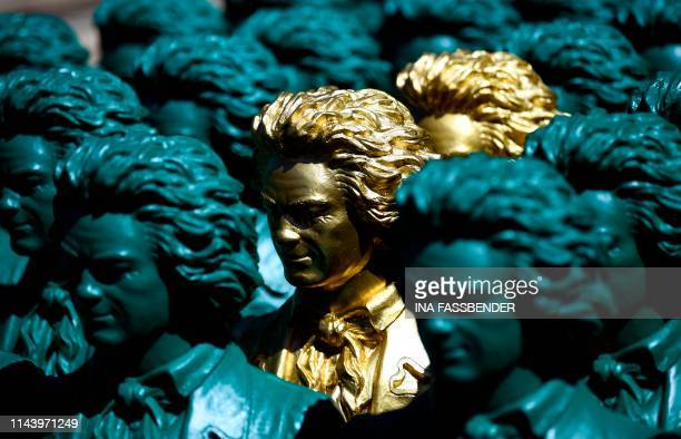 Sculptures representing German composer Ludwig van Beethoven and made by conceptual artist Ottmar Hoerl are displayed on May 15 2019 at the...
